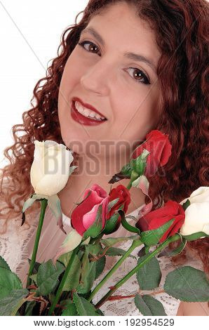 A closeup image of a beautiful woman holding a bunch of roses for valentine isolated for white background.