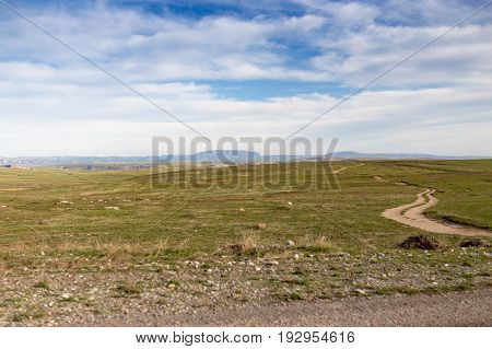 Steppes and mountains in Kazakhstan as a background .
