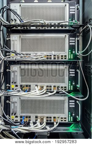 Cabinet with network server equipment, connected with wires. Technology background