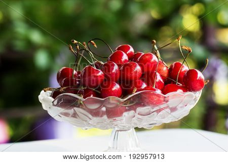 Ripe Juicy Red Cherry  In A Glass Bowl