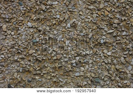 The Concrete Wall Issued By Small Decorative Pebbles
