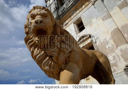 A Statue Of A Lion Guards The Cathedral Of Leon