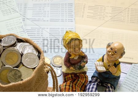 Senior happy smiling couple dolls group of Thai baht coin in mini