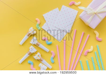 Birthday greeting cards on yellow background top view copyspace.