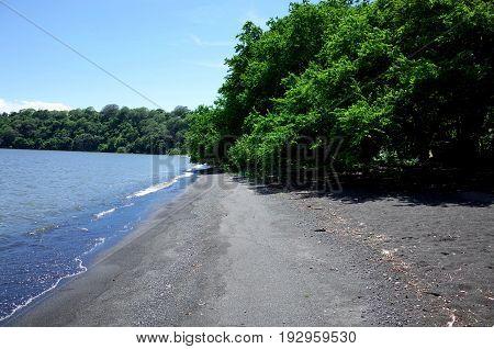 Black Volcanic Sand On A Beach On Isla Ometepe