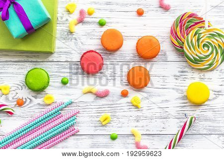 Birthday concept with wrapped gift and sweets on grey background top view.