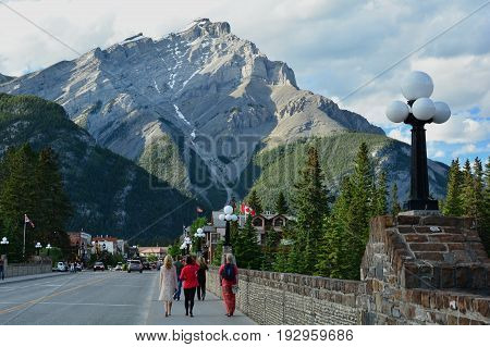 Banff National  Park,Alberta Canada,July 5th 2014.Main street of Banff Alberta with Mount Norquay in the background.