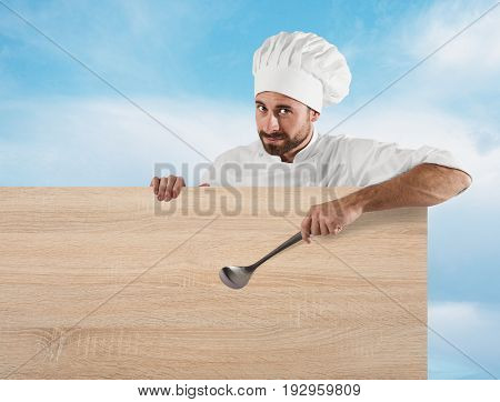 Smiling chef with ladle indicates a board