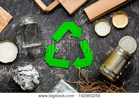 Garbage for recycling with recycling symbol on grey table background top view.