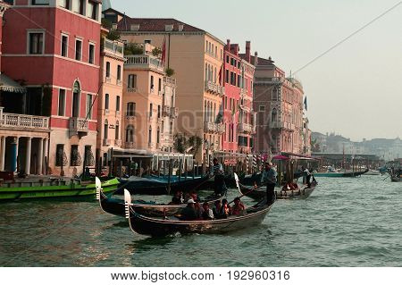 Venice Italy,October 16th 2013.Gondoliers take tourists on a gondola ride on the Grand Canal passing fine hotels in Venice Italy.