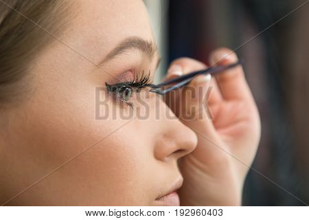 Beautiful woman fake eyelashes by сщыьуешс tweezers