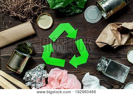 Eco concept with recycling symbol on wooden table background top view.