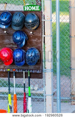 Baseball bats, helmets and balls on the home team side