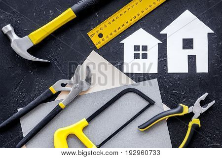 Reparing home concept. Tools on black stone desk background top view.