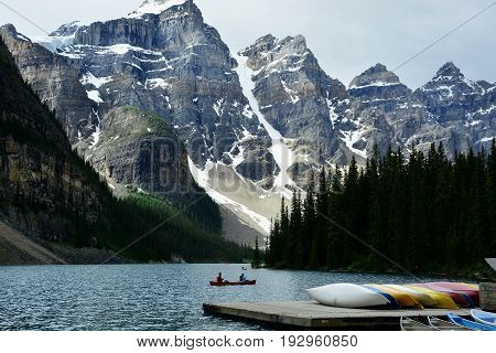 Moraine lake,Banff Alberta,Canada,July 5th 2014.Moraine lake in Banff National park is a great place for canoeing with the mountain landscape all around.Come to Banff and explore.