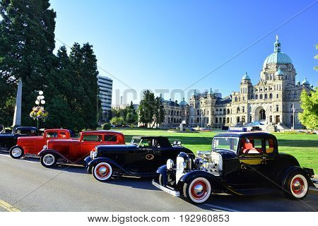 Victoria BC,Canada,July 24th 2016.Classic cars lined up on the streets of Victoria in front of the legislature during the classic car show.