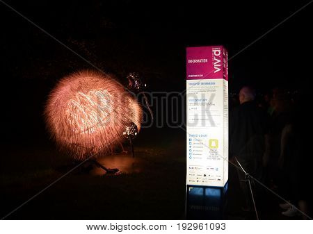 Sydney Australia - Jun 15 2017. Birds of Lumos introduces us to 'Rowi' the kiwi and her baby chick; she wears sight-enhancing goggles during Vivid Sydney colour light sound and motion festival.