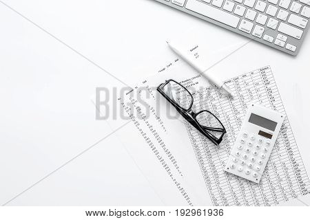business accounter work with taxes and keyboard on white office desk background top view mock up
