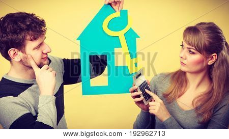 Young Couple Worried About Money For House.