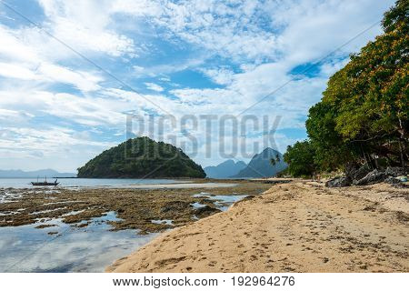 EL NIDO, PALAWAN, PHILIPPINES - MARCH 29, 2017: Colorful day in the beautiful beach of Las Cabanas.