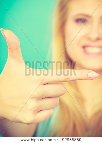 Happy Blonde Woman Pointing With One Finger