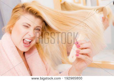 Woman Wearing Dressing Gown Brushing Her Hair
