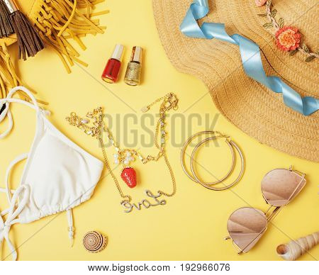 diverse travel girlish stuff on colorful background blue and yellow, nobody tourism lifestyle concept close up