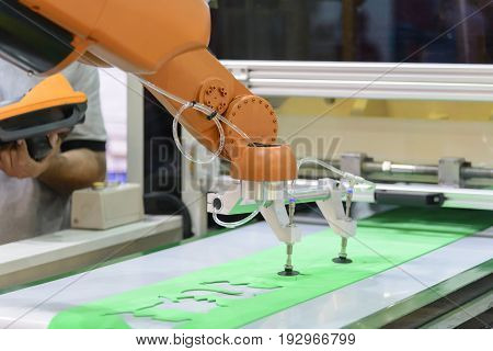The automatic robot arm for sheet metal forming factory. Industrial 4.0 concept.Modern technology for manufacturing