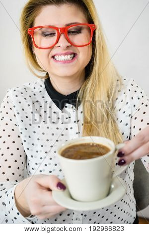 Happy Woman At Office Drinking Hot Coffee