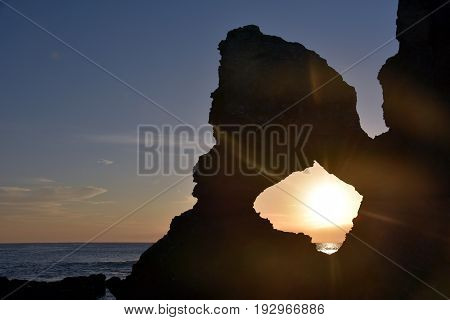 Sunrise at Australia rock in Narooma. The shape of Australia cut into the rock wall was accidental and was created when a ship was tied to the rock with large chains to prevent it from washing away.