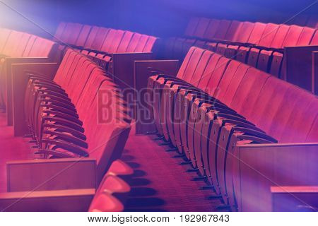 old red chairs at the empty vintage theatre