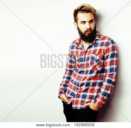young handsome hipster bearded guy looking brutal isolated on white background, lifestyle people concept copyspace