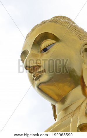 face of golden budda  isolated on white background.