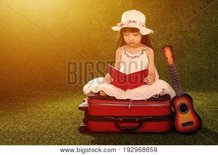 Asian Little Chinese Girl Reading Book