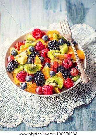 Fruit fresh mixed tropical fruit salad. Bowl of healthy fresh fruit salad - died and fitness concept.