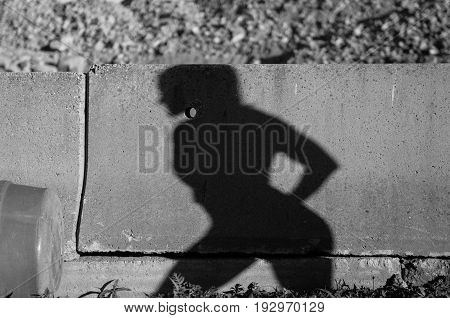 Atheltic woman's shadow in quarry in black and white