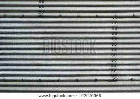An abstract image of corrugated steel storage bin.