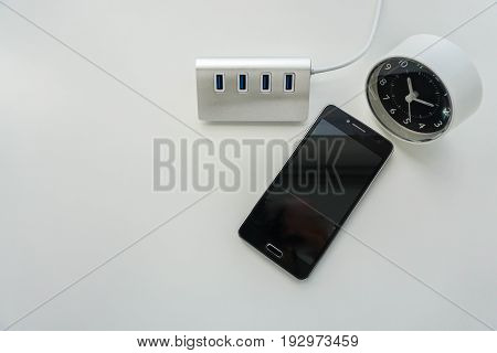 isolated USB hub for smartphone battery charge with rounded modern clock