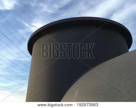 close up large old smokestack in factory