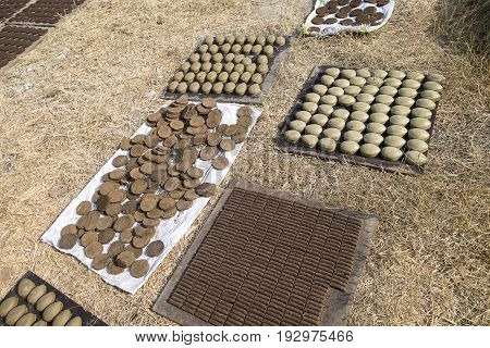 Drying of Ayurvedic semifinished products containing cow manure. One of the stages of the production in the ancient Ayurvedic medicine in the sacred Indian city of Vrindavan