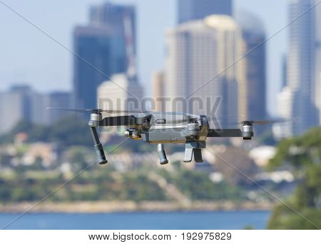 Sydney, Australia - May 11, 2017: A DJI Mavic Pro drone flying near city centre. Many countries have implemented laws to regulate the use of drones to ensure public safety.