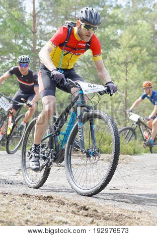 STOCKHOLM SWEDEN - JUNE 11 2017: Closeup of group of mountain bike cyclists in the forest at Lida Loop Mountain bike Race. June 11 2017 in Stockholm Sweden