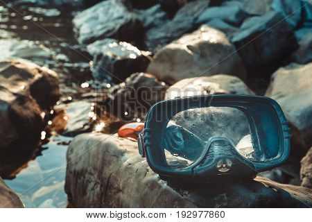 Mask For Diving And Snorkel Lie On The Beach On The Rocks Closeup. Tourism And Travel Concept