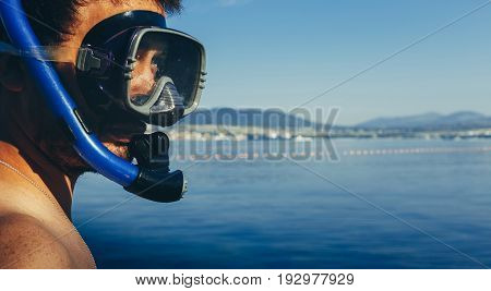 Young Man Diver With Mask For Diving And Snorkel On Background Of Sea With Space. Tourism Travel Journey Freediving Concept
