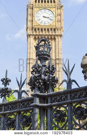 Decorative metal fence of Palace of Westminster Clock tower with Big Ben London England. The tower is officially known as Elizabeth Tower it was known as the Clock Tower.
