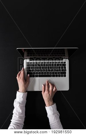 Cropped Shot Of Woman Working On Laptop Isolated On Black