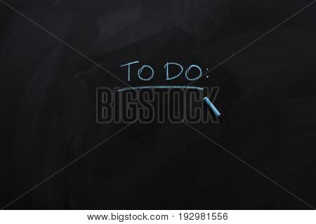 underlined to do note drawn with chalk on blackboard