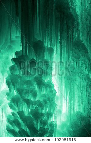 Huge Ice Icicles. Large Blocks Of Ice Frozen Waterfall Or Water. Light Green Ice Background. Frozen