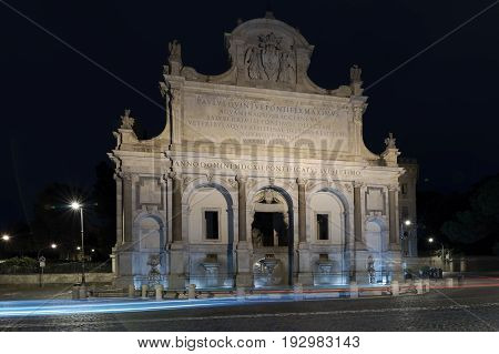 Monumental fountain of the Gianicolo is the great exhibition of Paola water coming from Lake Bracciano. Rome Italy. Night view.