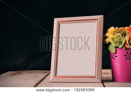 Picture frames and vases of flowers on the old wooden floor.